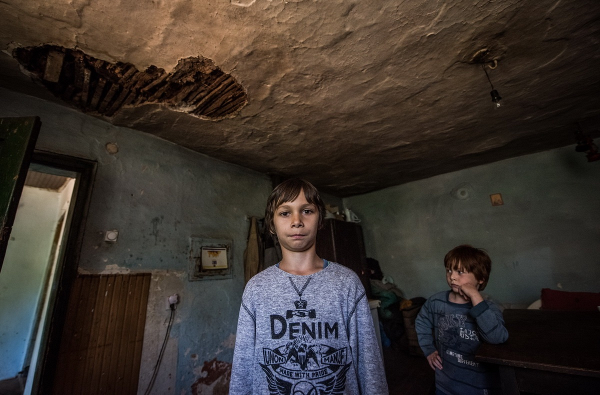 """""""Be careful, those are your only shoes"""" – children living in a 170 year old home with a big hole in the roof above their heads"""
